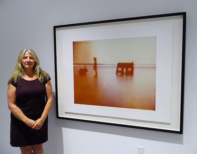 Susan Mikula beside her art work