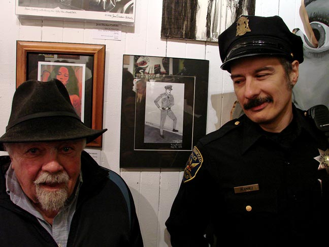 Mark Alvarez in front of a drawing I presented of him. On the left is George Tsongas, local North Beach poet.